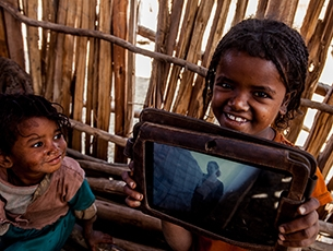 picture of an african girl with a tablet